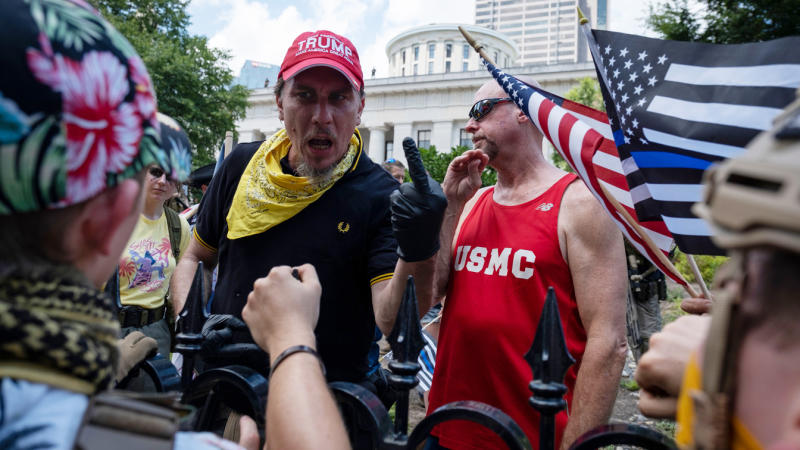 """Protestors exchange words and rude gestures in front of the Ohio Statehouse during a right-wing protest """"Stand For America Against Terrorists and Tyrants"""" at State Capitol on July 18, 2020 in Columbus, Ohio. (Jeff Dean/AFP via Getty Images)"""