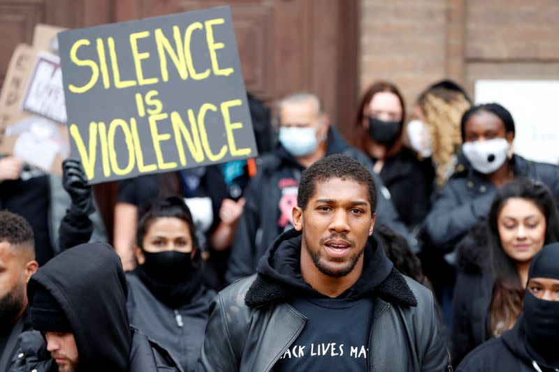 World boxing champion Joshua attends march, says racism is a pandemic
