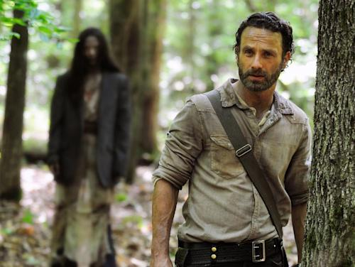 "This image released by AMC shows Andrew Lincoln as Rick Grimes in a scene from the season four premiere of ""The Walking Dead,"" airing Oct. 13 at 9 p.m. EST. (AP Photo/AMC, Gene Page)"