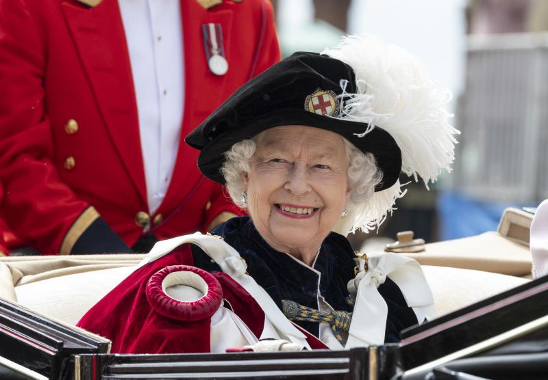 Queen Elizabeth smiles at the Order of the Garter