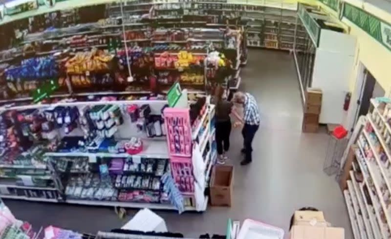 Man, identified by police as Gomoll, appears to wipe his nose and face on the shirt of a Dollar Tree store employee