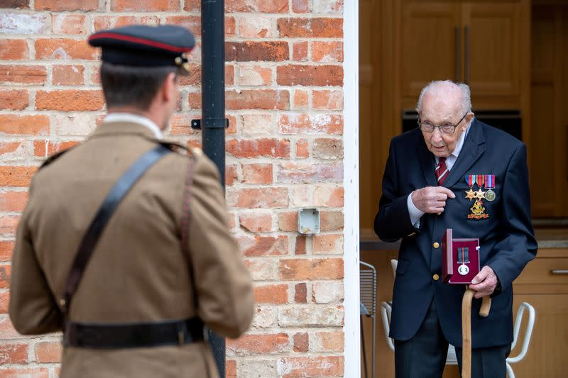 Former British Army Officer Captain Tom Moore, appointed the first Honorary Colonel of the Army Foundation College in Harrogate, holds his Yorkshire Regiment Medal next Lieutenant Colonel Thomas Miller in Bedford