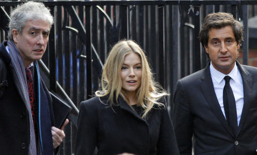 British actress Sienna Miller, center, arrives to testify at the Leveson inquiry at the Royal Courts of Justice in central London, Thursday, Nov. 24, 2011. The Leveson inquiry is Britain's media ethics probe that was set up in the wake of the scandal over phone hacking at Rupert Murdoch's News of the World, which was shut in July after it became clear that the tabloid had systematically broken the law. (AP Photo/Lefteris Pitarakis)