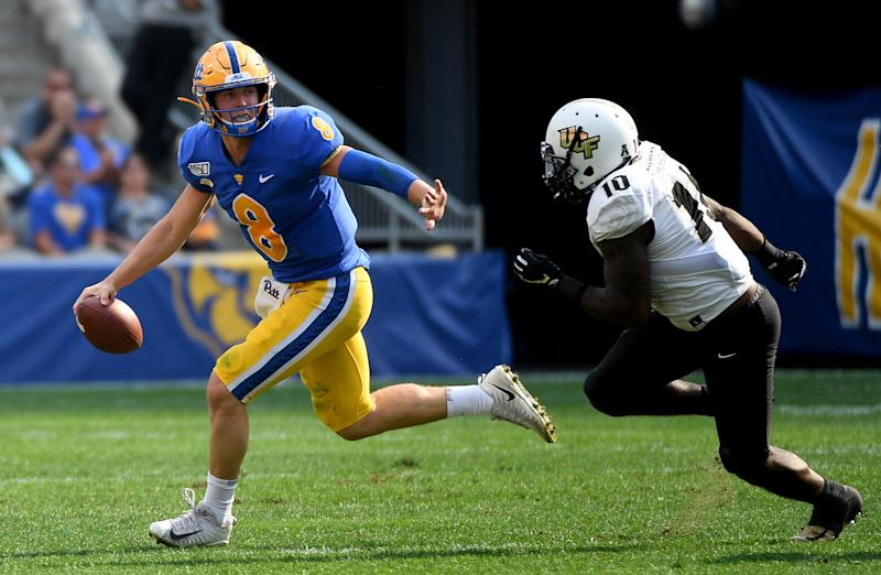 PITTSBURGH, PA - SEPTEMBER 21: Kenny Pickett #8 of the Pittsburgh Panthers scrambles under pressure from Eriq Gilyard #10 of the UCF Knights in the first quarter during the game at Heinz Field on September 21, 2019 in Pittsburgh, Pennsylvania. (Photo by Justin Berl/Getty Images)