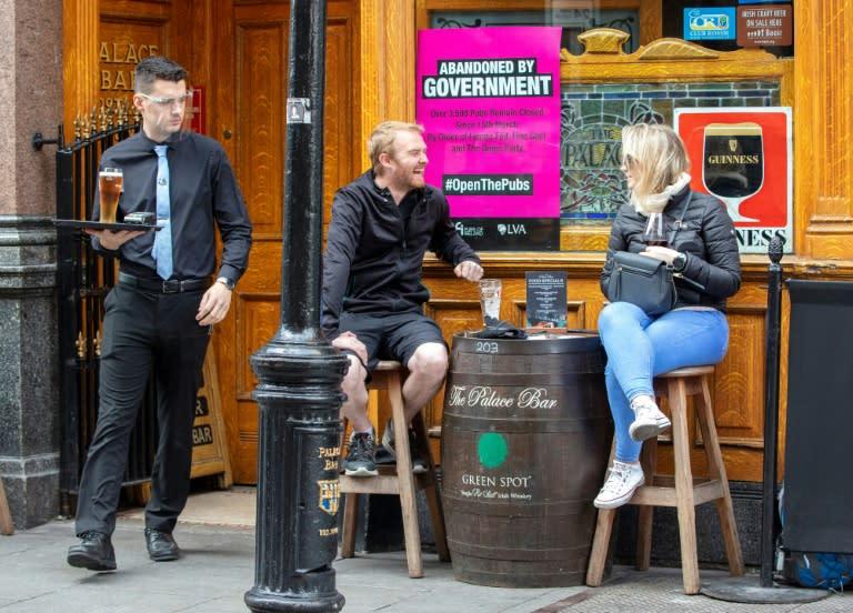 Irish pubs open after virus closure but Dublin stays dry
