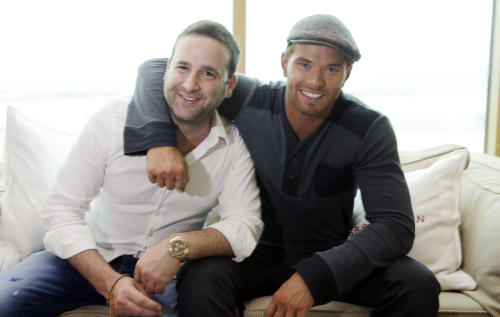 Actor-designer Kellan Lutz, right, and his business partner Danny Guez pose for a portrait to promote their clothing line Abbot + Main's pre-spring 2014 collection at the Mandalay Bay Hotel on Monday, Aug. 19, 2013 in Las Vegas. (Photo by Isaac Brekken/Invision/AP)