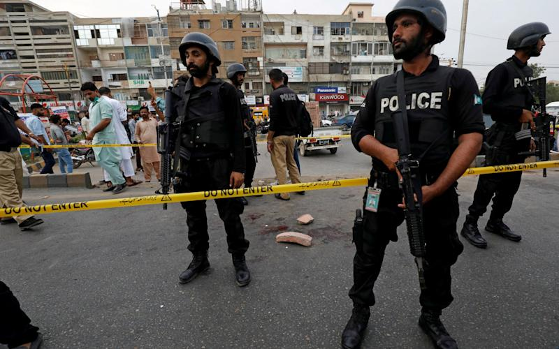 Police in Indian-administered are investigating the killings. The Indian army initially claimed the three were militants - AKHTAR SOOMRO/REUTERS