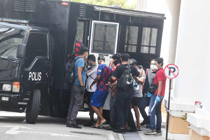 Seven men who were arrested by the police were seen at the Magistrate's Court in George Town March 27, 2020. ― Picture by Sayuti Zainudin
