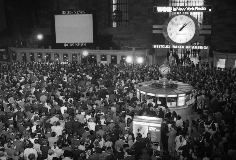 FILE - In this April 17, 1970 file photo, crowds watch a television screen in New York's Grand Central Station waiting for the safe arrival of the Apollo 13 astronauts in the Pacific Ocean. (AP Photo/J. Spencer Jones)