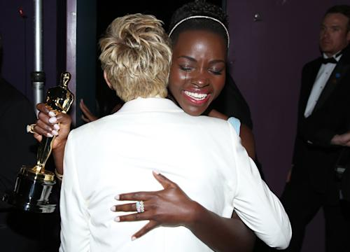 "Ellen DeGeneres, left, embraces Lupita Nyong'o backstage after she won best supporting actress for ""12 Years a Slave"" during the Oscars at the Dolby Theatre on Sunday, March 2, 2014, in Los Angeles. (Photo by Matt Sayles/Invision/AP)"