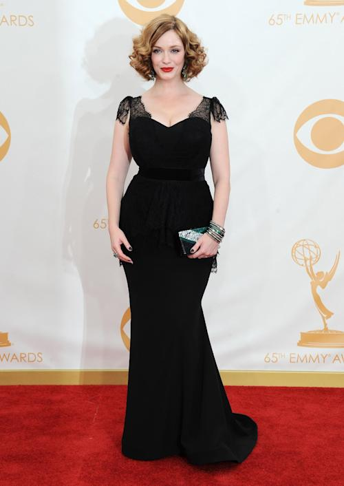 Christina Hendricks arrives at the 65th Primetime Emmy Awards at Nokia Theatre on Sunday Sept. 22, 2013, in Los Angeles. (Photo by Jordan Strauss/Invision/AP)