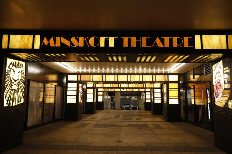 The Minskoff Theatre is shuttered Thursday, March 12, 2020, in New York, near Times Square after Broadway theaters closed following New York Gov. Andrew Cuomo's banning of gatherings of more than 500 people over concerns about the spread of the coronavirus. As positive tests for COVID-19 have risen daily over the last week in New York City, it's streets and popular landmarks have steadily emptied and grown quiet of tourist and locals. As of Sunday morning, nearly 2,000 people with the virus have been hospitalized in the state of New York and 114 have died, officials said. (AP Photo/Kathy Willens)