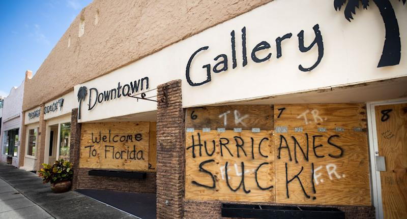 Florida graffiti on boarded-up wall as residents braced for Hurricane Dorian.