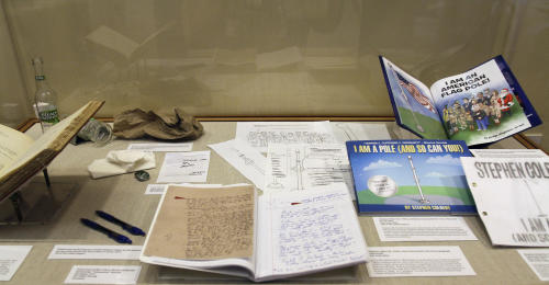 "A display of sketches, manuscript, pens, beer bottles and a book is seen from talk show host Stephen Colbert at the Rosenbach Museum & Library Monday, July 30, 2012, in Philadelphia. A new exhibit pairs priceless material by James Joyce and Maurice Sendak with items Colbert used to create his children's book ""I Am A Pole (And So Can You!)."" (AP Photo/Brynn Anderson)"