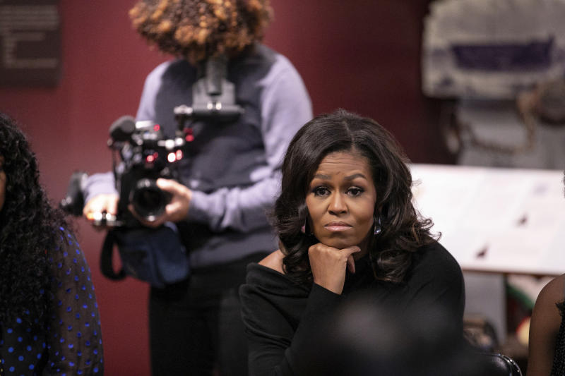 """This image released by Netflix shows former first lady Michelle Obama in a scene from """"Becoming."""" (Isaac Palmisano/Netflix via AP)"""