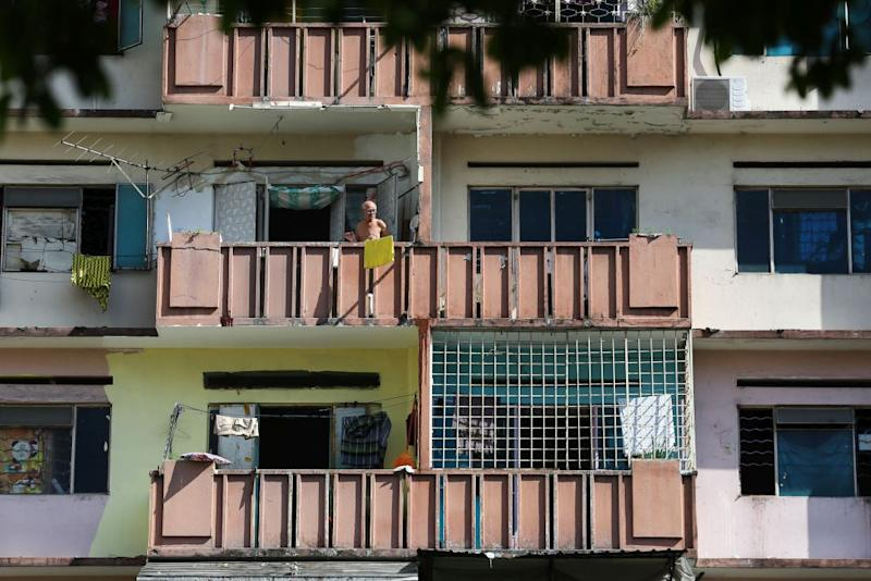 A man is seen at the balcony of his flat unit in Selangor Mansion, Kuala Lumpur April 11, 2020. — Picture by Yusof Mat Isa