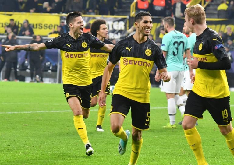 Moroccan defender Achraf Hakimi (C) celebrated with his Borussia Dortmund team-mates after scoring two goals in the stunning 3-2 win over Inter Milan three weeks ago