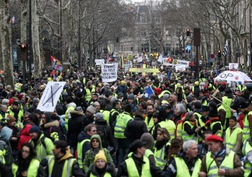 'Switch off your telly. Come and meet us': thousands of 'yellow vest' demonstrators marched in Paris