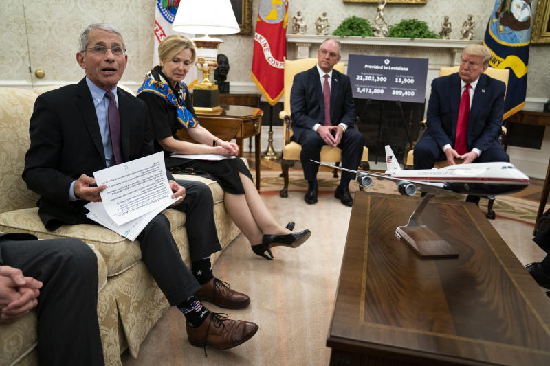 FILE - In this April 29, 2020, file photo Director of the National Institute of Allergy and Infectious Diseases Dr. Anthony Fauci speaks during a meeting between President Donald Trump and Gov. John Bel Edwards, D-La., about the coronavirus response, in the Oval Office of the White House in Washington. From left, Fauci, White House coronavirus response coordinator Dr. Deborah Birx, Bel Edwards, and Trump. (AP Photo/Evan Vucci)