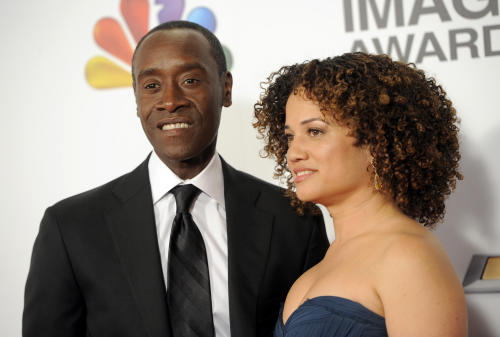 Don Cheadle, left, and Bridgid Coulter arrive at the 44th Annual NAACP Image Awards at the Shrine Auditorium in Los Angeles on Friday, Feb. 1, 2013. (Photo by Chris Pizzello/Invision/AP)