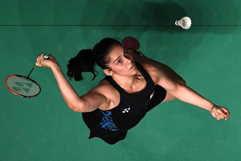 Saina Nehwal of India hits a return against Nozomi Okuhara of Japan in their women's singles match at the Malaysia Masters badminton tournament in Kuala Lumpur on January 18, 2019. (Photo by MOHD RASFAN / AFP) (Photo credit should read MOHD RASFAN/AFP/Getty Images)