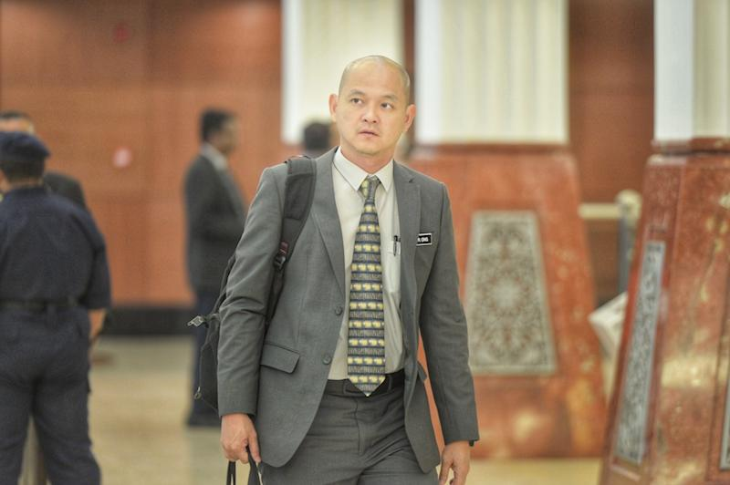 Former deputy international trade and industry minister Ong Kian Ming, arrives in Parliament November 20, 2019. — Picture by Shafwan Zaidon