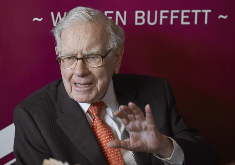 FILE - In this May 5, 2019, file photo Warren Buffett, Chairman and CEO of Berkshire Hathaway, speaks during a game of bridge following the annual Berkshire Hathaway shareholders meeting in Omaha, Neb. Berkshire Hathaway Inc. reports earnings on Saturday, Aug. 3. (AP Photo/Nati Harnik, File)
