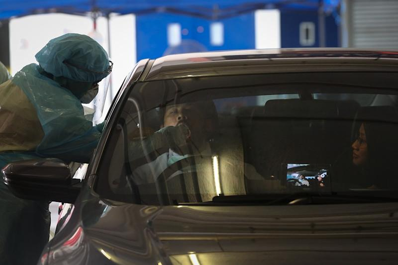 A health worker in protective suit collects swab samples from a motorist at a drive-through testing site for Covid-19 at MSU Medical Centre in Shah Alam April 10, 2020. — Picture by Yusof Mat Isa
