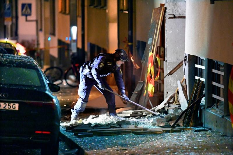 FILE PHOTO: Police work on the site where an explosion damaged a residential building in central Stockholm