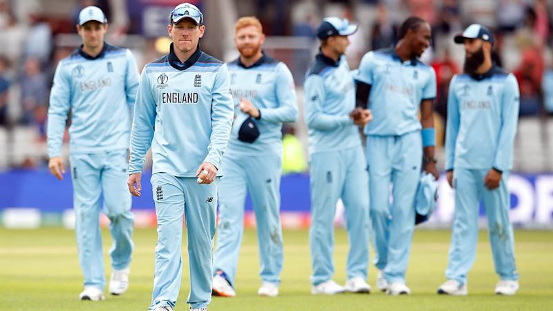 Eoin Morgan and teammates celebrate. (Photo by Martin Rickett/PA Images via Getty Images)