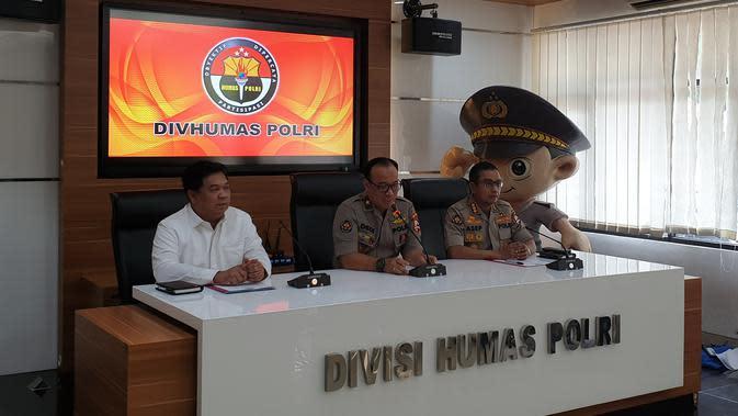 Polri menetapkan seorang oknum polisi sebagai tersangka kasus penembakan mahasiswa Kendari saat demo. (Nanda Perdana Putra/Liputan6.com)