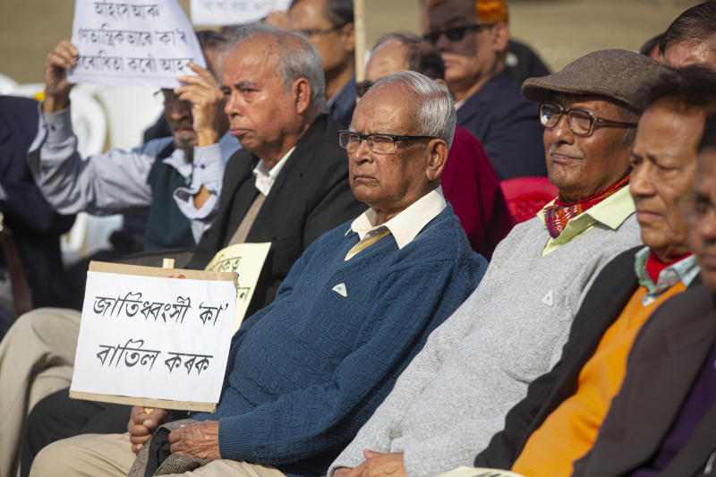 Retired college teachers participate in a protest against the Citizenship Amendment Act in Gauhati, India, Friday, Dec. 27, 2019. Tens of thousands of protesters have taken to India's streets to call for the revocation of the law, which critics say is the latest effort by Narendra Modi's government to marginalize the country's 200 million Muslims. (AP Photo/Anupam Nath)