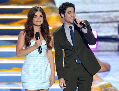 Hosts Lucy Hale, left, and Darren Criss speak on stage at the Teen Choice Awards at the Gibson Amphitheater on Sunday, Aug. 11, 2013, in Los Angeles. (Photo by John Shearer/Invision/AP)