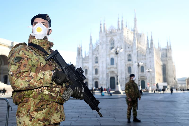 FILE PHOTO: Military officers stand outside Duomo cathedral in Milan