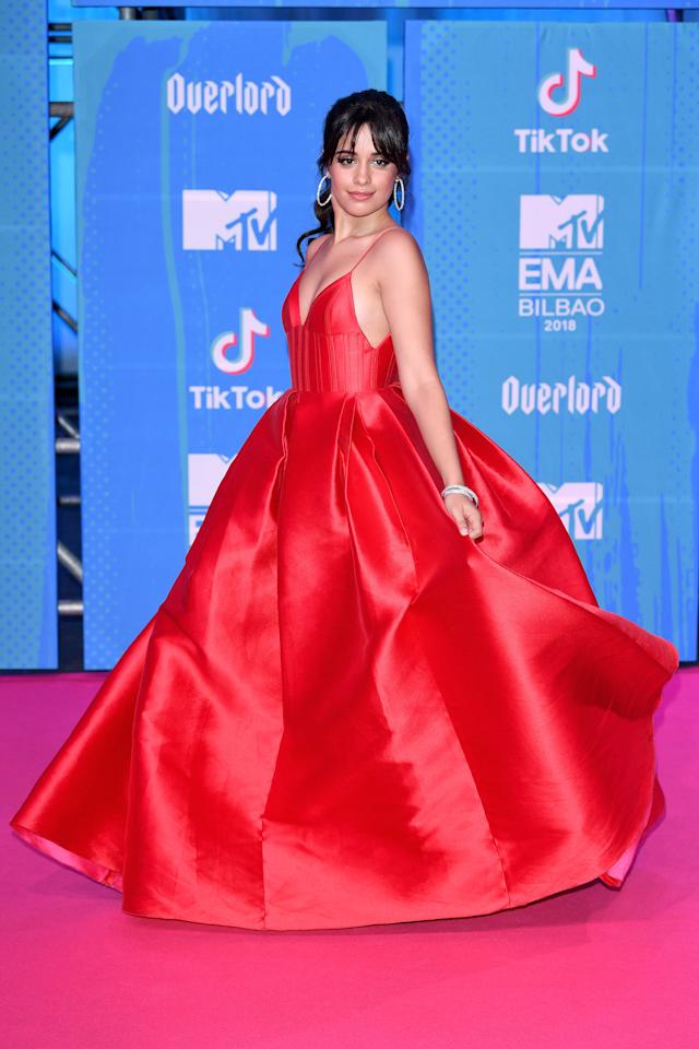 <p>'Havana' singr Camila Cabello was the belle of the ball in this stunning red gown on the MTV EMA Awards pink carpet. Photo: Getty Images </p>