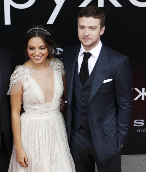 "Actors Justin Timberlake and Mila Kunis pose for a picture before the premiere of their new film ""Friends with Benefits"" at the Oktyabr (October) cinema in Moscow"