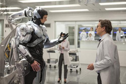 "This image released by Columbia Pictures shows Joel Kinnaman, left, and Gary Oldman in a scene from ""RoboCop."" (AP Photo/Columbia Pictures - Sony, Kerry Hayes)"