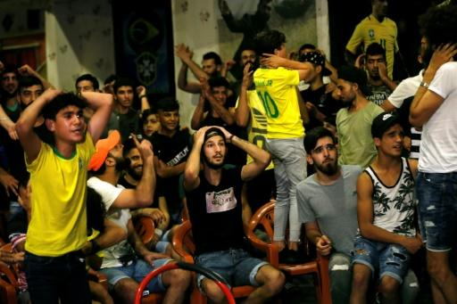 Lebanese fans watch Brazil play Belgium in the World Cup on July 6, 2018, in the Ersal district of southern Beirut