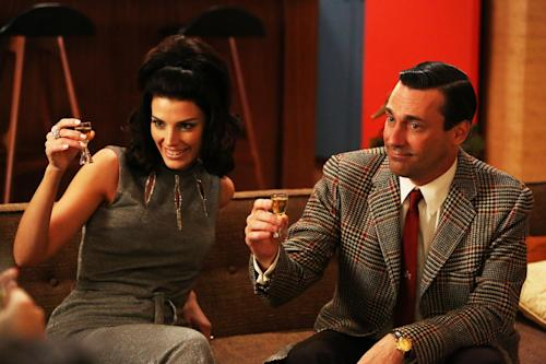 "This publicity photo provided by AMC shows Jessica Pare as Megan Draper and Jon Hamm as Don Draper in a scene of ""Mad Men,"" Season 6, Episode 2. ""Mad Men"" returns for its sixth season Sunday, April 7, 2013, on AMC with 13 new episodes. Series Creator Matthew Weiner says he plans one more season for the 1960s drama. (AP Photo/AMC, Michael Yarish)"