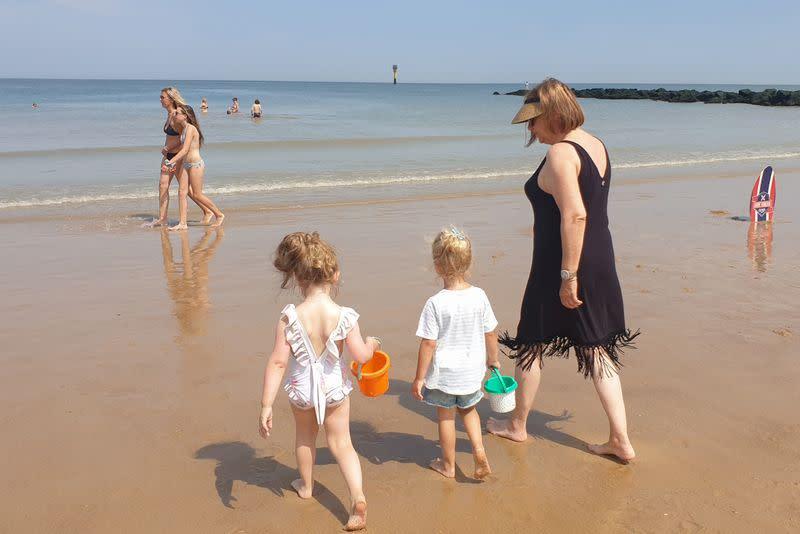 People enjoy a hot summer day on a beach during the coronavirus disease (COVID-19) outbreak, in Knokke-Heist