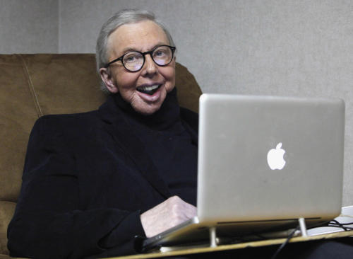 FILE - In this Jan. 12, 2011 file photo, Pulitzer Prize-winning movie critic Roger Ebert works in his office at the WTTW-TV studios in Chicago. The Chicago Sun-Times is reporting that its film critic Roger Ebert died on Thursday, April 4, 2013. He was 70. (AP Photo/Charles Rex Arbogast, File)