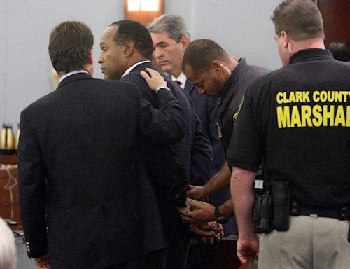 FILE - In this Friday, Oct. 3, 2008 file photo, O.J. Simpson is handcuffed after a verdict of guilty on all counts was read following his trial at the Clark County Regional Justice Center in Las Vegas. The verdict comes 13 years to the day after Simpson was acquitted of murdering his ex-wife Nicole Brown Simpson and Ron Goldman. The return of O.J. Simpson to a Las Vegas courtroom next Monday, May, 13, will remind Americans of a tragedy that became a national obsession and in the process changed the country's attitude toward the justice system, the media and celebrity. The return of O.J. Simpson to a Las Vegas courtroom next Monday, May, 13, will remind Americans of a tragedy that became a national obsession and in the process changed the country's attitude toward the justice system, the media and celebrity. (AP Photo/Steve Marcus, Pool)
