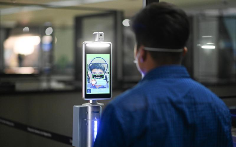 A passenger has his temperature measured upon landing at La Aurora airport - Getty