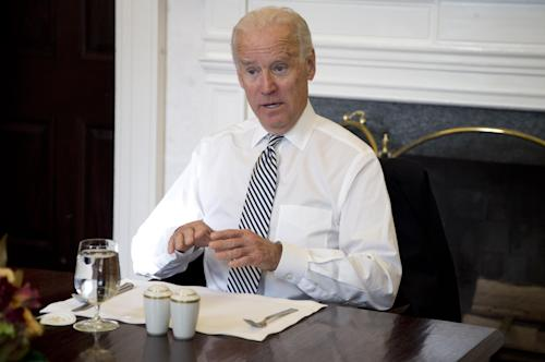 Vice President Joe Biden gestures as he speaks during a photo-op as he meets with President Barack Obama for lunch in the Private Dining Room of the White House in Washington, Wednesday, Jan. 8, 2014. (AP Photo/Carolyn Kaster)