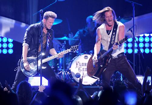 FILE - in this Dec. 10, 2013 file photo, Brian Kelley, left, and Tyler Hubbard, of musical group Florida Georgia Line, perform at the American Country Awards at the Mandalay Bay Resort & Casino, in Las Vegas. The first iHeartRadio Country Festival will be held March 29, 2014, in Austin, Texas, with Luke Bryan, Jason Aldean, Eric Church, Carrie Underwood, Lady Antebellum and Florida Georgia Line heading up the initial lineup. (Photo by Frank Micelotta/Invision/AP, File)