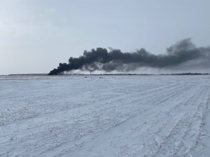 Smoke rises from the site of burning railcars at a CP Rail train derailment near Guernsey