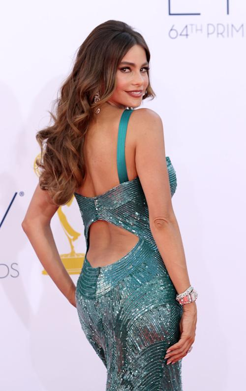 "Sofia Vergara from ""Modern Family"" arrives at the 64th Primetime Emmy Awards at the Nokia Theatre on Sunday, Sept. 23, 2012, in Los Angeles. (Photo by Matt Sayles/Invision/AP)"
