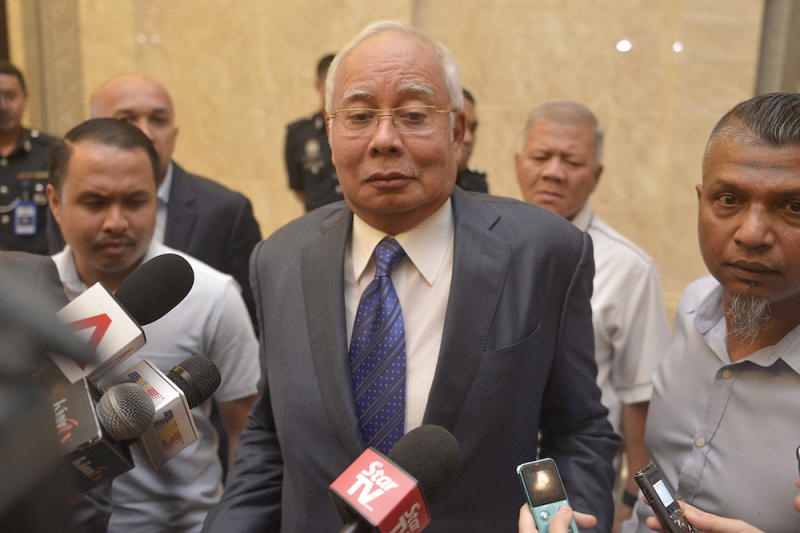 Datuk Seri Najib Razak reacts to questions from reporters at the Palace of Justice in Putrajaya February 11, 2019. — Picture by Mukhriz Hazim