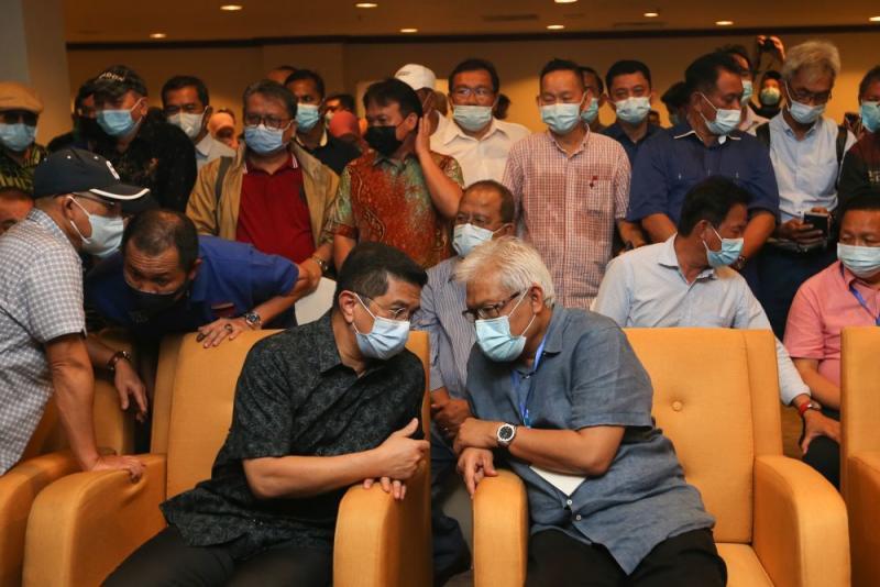 Perikatan Nasional information chief Datuk Seri Mohamed Azmin (seated, left) speaks to Datuk Seri Hamzah Zainudin at the Magellan Sutera Resort in Kota Kinabalu September 26, 2020. — Picture by Firdaus Latif