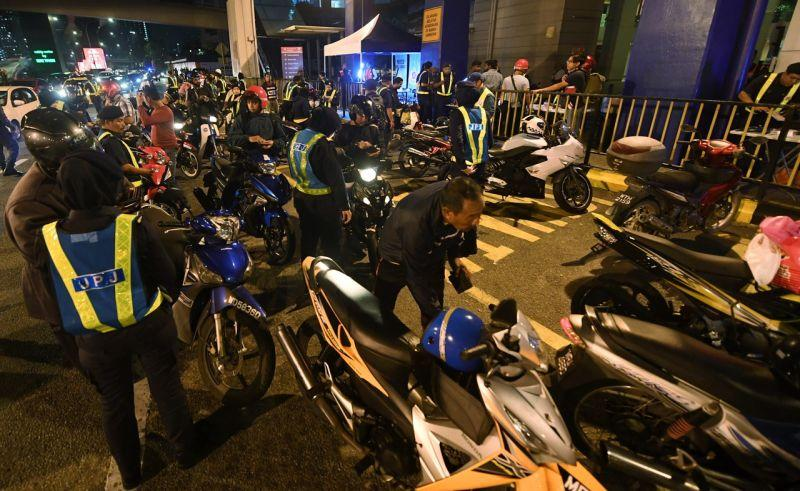 RTD personnel conduct checks on motorcyclists during an operation in Bangsar February 19, 2018. — Bernama pic